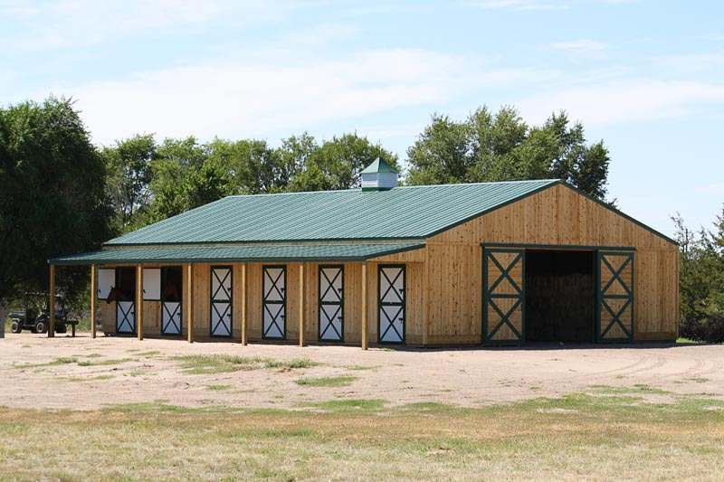 Equestrian buildings and beautiful colorado horse barns for Horse barn materials